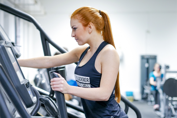 fitness girl on a crosstrainer