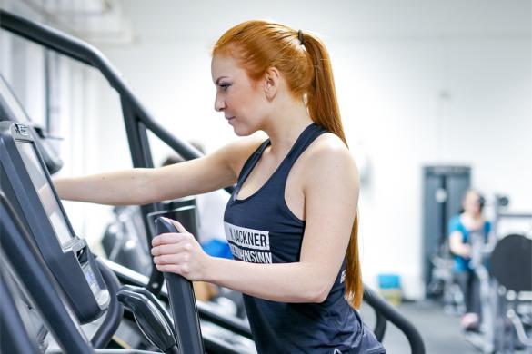 fitness girl on a crosstrainer