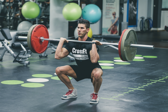 man train in the gym with a barbell