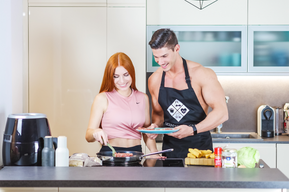 fitnesscouple cooking in the kitchen